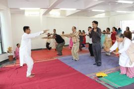 5th International Day of Yoga- NARI staff practicing Yoga with the Yoga teacher.