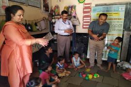 ICMR-NARI, Pune staff explaining hand washing technique to anganwadi (school) children