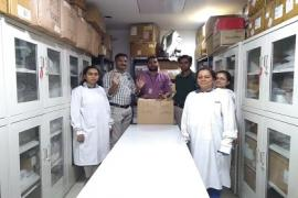Laboratory staff cleaning the laboratory area.